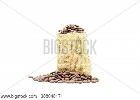 Coffee Beans Roasted In Sack And Pile Of Coffee Beans On White Background.