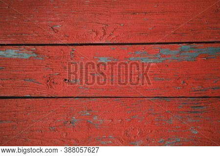 Three Grunge Wooden Boards With Weathered, Peeling Red Paint. Vintage Backdrop