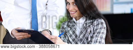 Portrait Of Businesswoman Signing Papers Sitting In Office. Attractive Young Woman Wearing Luxury Pr