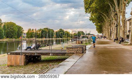 Orleans, France, October 10, 2019: Pedestrians Walking On Orleans Boulevard Along The River Loire Du