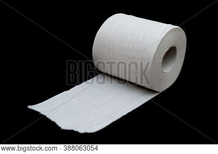 Single Roll Of Unrolled White Toilet Paper. Isolated On Black Background. Close-up. Copy Space. Hori
