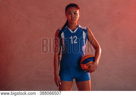 Young Woman Smiling Volleyball Player With Ball