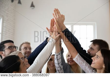 Excited Diverse Businesspeople Give High Five Participate In Teambuilding