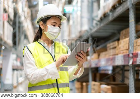 Young Asian Woman Auditor Or Trainee Staff Wears Mask Working During The Covid Pandemic In Store War