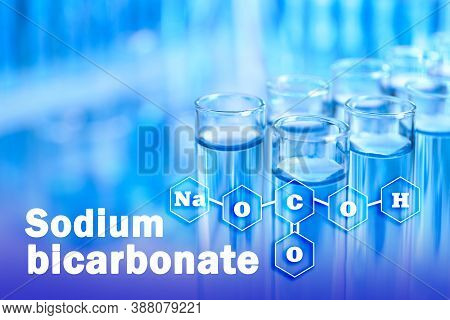 Text Sodium Bicarbonate With Soda Formula And Test Tubes On Background