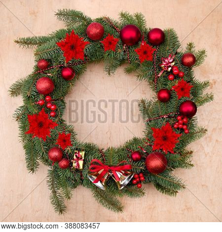 Christmas Decoration. Wreath Of Flowers Of Red Poinsettia, Branch Christmas Tree, Ball, Red Berries