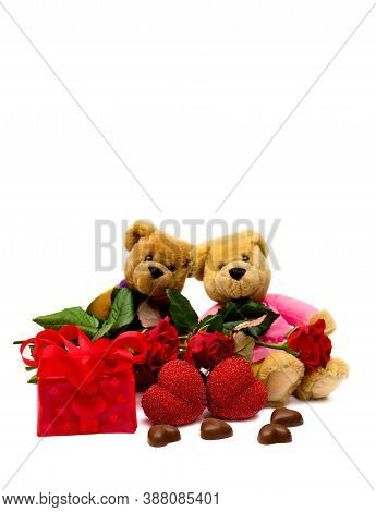 Valentine's Composition With Two Snugly Teddy Bears, Roses, Chocolaty Candy, Gift Box And Hearts On