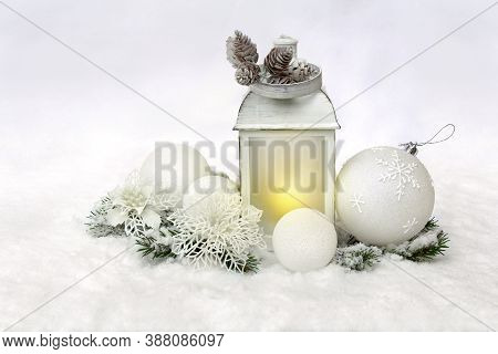 Christmas Decoration. Christmas Lantern, White Balls, Cones, White Openwork Flowers, Twigs Christmas