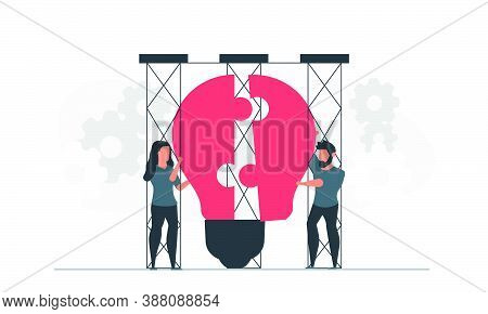 Creative People With Innovative Ideas. A Man And Woman Are Holding A Large Light Bulb. Talented Peop
