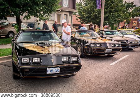 Toronto, Canada - 08 18 2018: Three Black Pontiac Firebird Trans Am T-top Coupe Oldtimer Cars With G