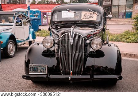 Toronto, Canada - 08 18 2018: Black 1937 Plymouth P4 Deluxe Oldtimer Car Made By American Automobile