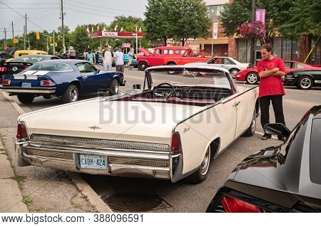 Toronto, Canada - 08 18 2018: Visitor Of Auto Show Wheels On The Danforth Beside Oldtimer Car -1964