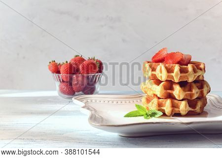 Stack Of Belgian Waffles With Strawberries On Fancy Plate