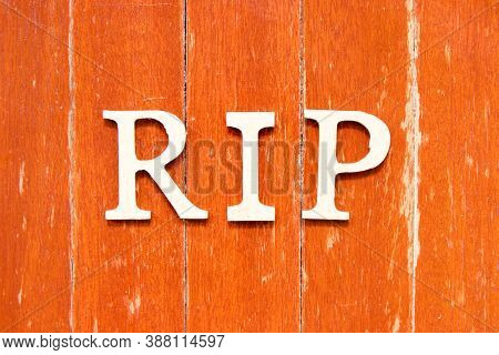 Alphabet Letter In Word Rip (abbreviation Of Rest In Peace) On Old Red Color Wood Plate Background