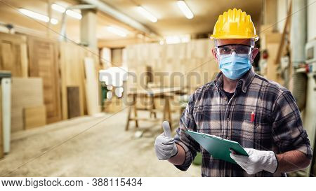 Carpenter At Work Protects The Face With The Surgical Mask. Carpentry. Covid-19 Prevention.