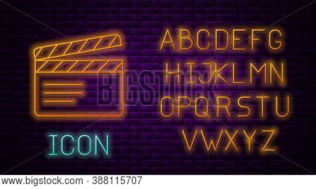 Glowing Neon Line Movie Clapper Icon Isolated On Brick Wall Background. Film Clapper Board. Clapperb