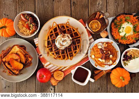 Fall Breakfast Or Brunch Buffet Table Scene Against A Dark Wood Background. Pumpkin Spice, Waffles,