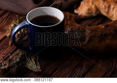 Homemade Pastries And A Cup Of Tea On An Old Wooden Surface. Homemade Strudel. Anise And Fragrant He