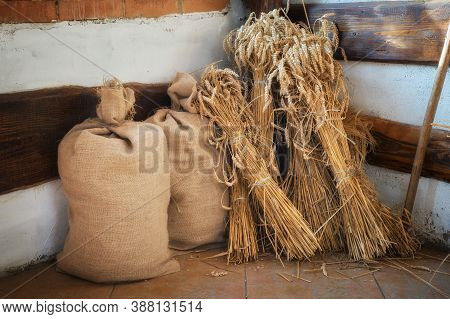 Sheaves Of Wheat Spikelets And Bags Of Flour.