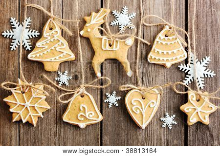 Christmas homemade gingerbread cookies over wooden table