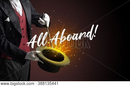 Magician is showing magic trick with All Aboard! inscription, traveling concept