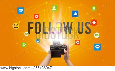 Using camera to capture social media content with FOLLOW US inscription, social media content concept