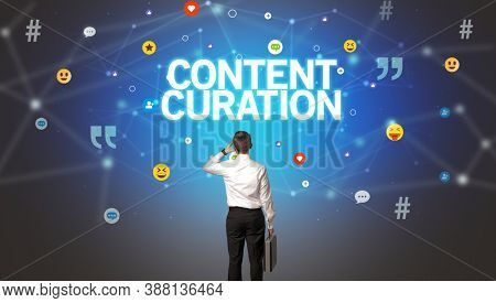 Rear view of a businessman with CONTENT CURATION inscription, social networking concept