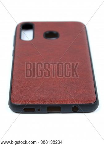 Moscow, Russia - February 22, 2020: Brown Smartphone On A White Background In A Transparent Case Fro