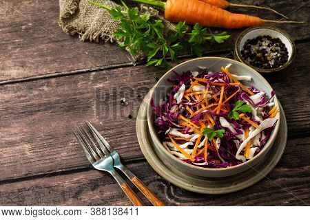 Salad Cole Slaw. Autumn Cabbage Salad In A Bowl On A Rustic Wooden Table. Copy Space.