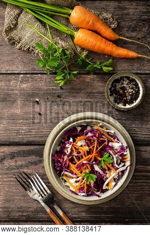 Salad Cole Slaw. Autumn Cabbage Salad In A Bowl On A Rustic Wooden Table. Flat Lay Top View. Copy Sp