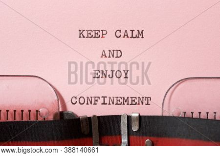 Keep calm and enjoy confinement phrase written with a typewriter.