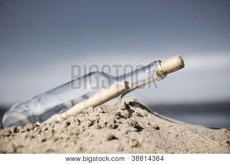 glass bottle with note washed up on the beach