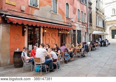 Venice, Italy, October 23 2019: Tourist People Sitting On A Restaurant In The Streets Of Neighbourho