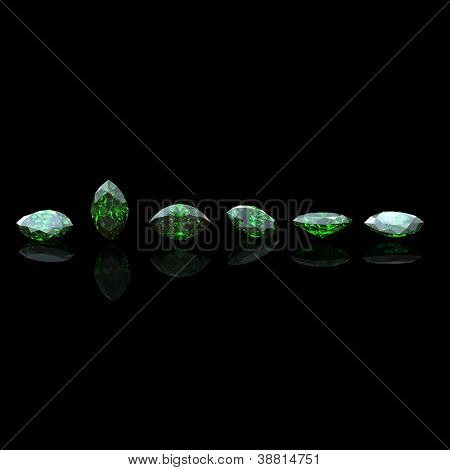 Marquis gemstone on black background. Emerald. Peridot