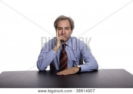 mature business man on a desk, isolated on white