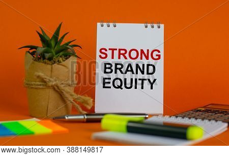 White Note With Inscription 'strong Brand Equity' On Beautiful Orange Background, Colored Paper, Met