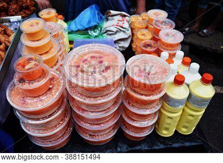 Red Rice And Yogurt In A Street Shop, Milk, Bacteria Used To Make Yogurt