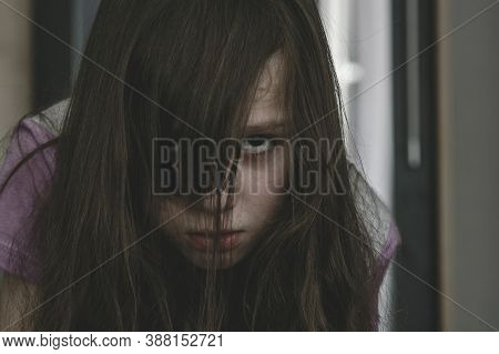 Closeup Portrait Of Little Girl In State Of Melancholy. Portrait Of Detached Child. Sad Look Of Girl