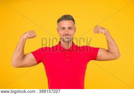 Commit To Be Fit. Strong Man Flex Arms Yellow Background. Physical Strength. Building Strong Biceps