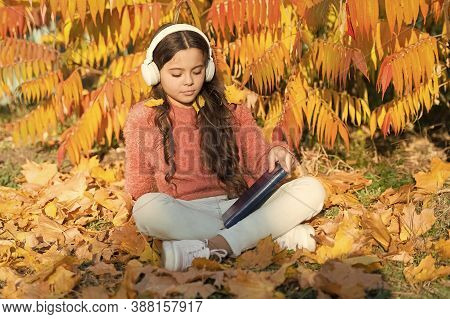 Self-study Lesson On Autumn Nature. Small Child Practice Listening On Free Time. Little Girl Listeni