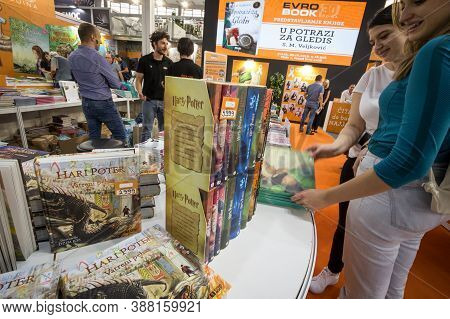 Belgrade, Serbia - October 10, 2019: Girls Reading And Looking At Covers Of Harry Potter Books In A