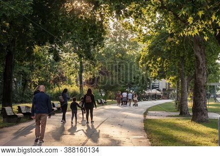 Belgrade, Serbia - July 19, 2020: Two Groups, Families, With Father, Mother And Young Children, Walk