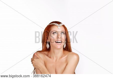Adorable Redhead Woman Wearing Tikka Crown Smiling, Laughing Looking Up Happy. Caucasian Person With