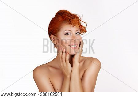 Beautiful Young Woman With Redhead, Ginger Culry Hair  Looking At You Smiling Slightly Hands Around