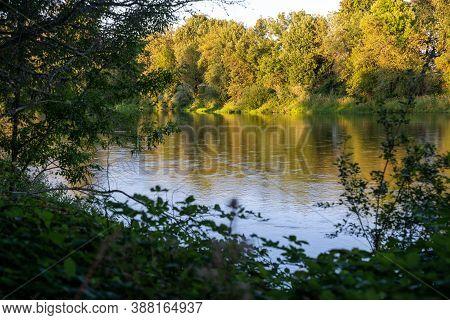 The Willamette River, Flowing Through Corvallis, Oregon At Dusk
