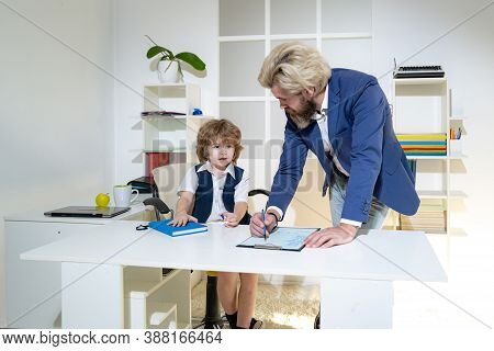 Business People Planning Strategy Analysis In Office. Cute Boy Kid Sitting In Office Chair Self Conf