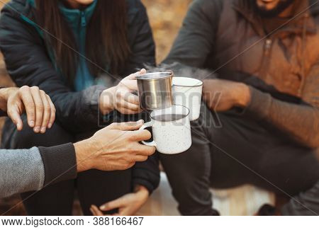 Warming Up In Camping. Hands Of International Hikers Cheering Up With Camping Cups, Camping In Fores