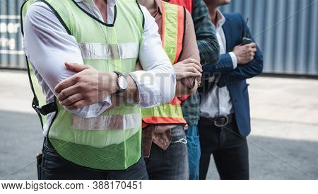Portrait Of Containers Ship Engineer Control Team Import/export Standing Against Box Container Backg