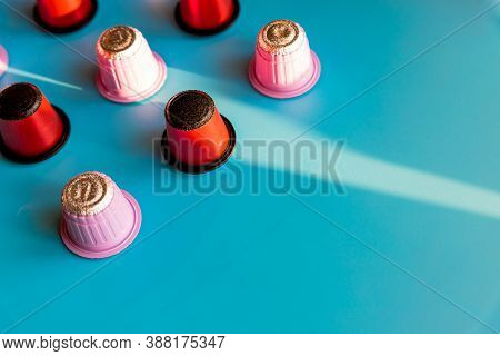 Italian Espresso Coffee Capsules Or Coffee Pods Composition On Blue Background, Flat Lay.coffee In C
