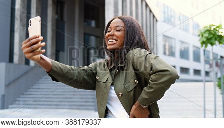 Beautiful Young African American Woman Posing And Smiling To Smartphone Camera While Taking Selfie P